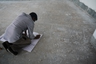 Hasib translating the map onto paper for the team to analyse later